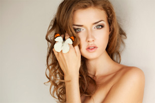 Girl modelling with butterfly on hand